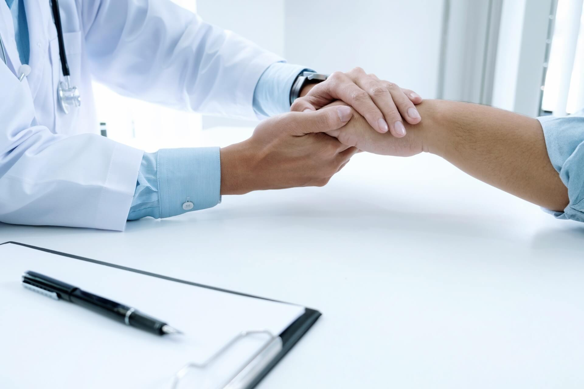 Doctor and patient holding hands